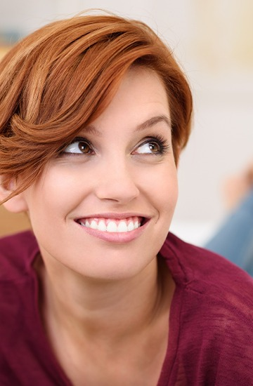 Woman smiling after gum recontouring