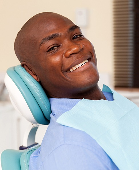Man smiling after tooth colored filling placement