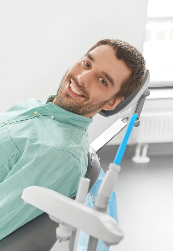 Dentist smiling while treating patient