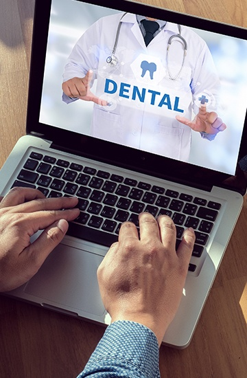 Dental insurance on laptop computer