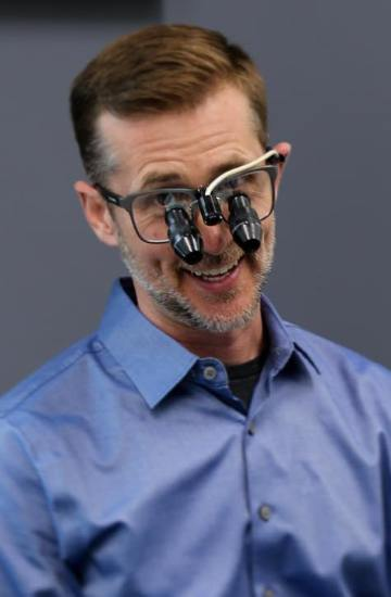Doctor Heck wearing dental treatment loupes